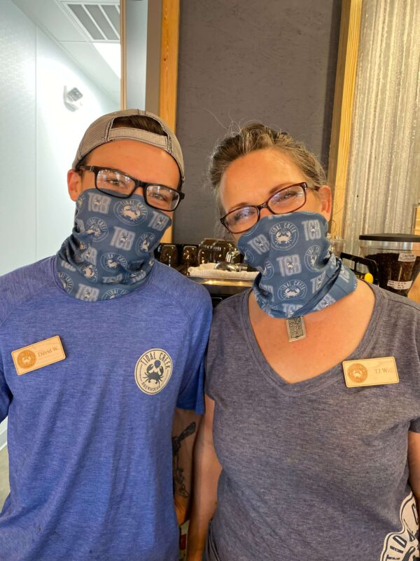 tidal creek brewhouse blue gaiter on man and woman