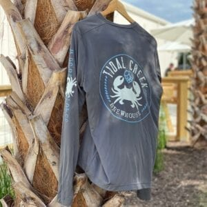 long sleeve uv shirt hanging on palm tree