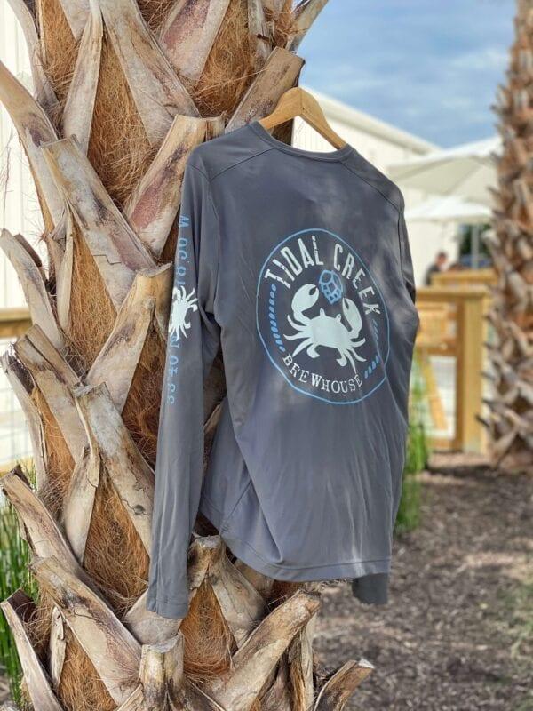 long sleeve uv shirt hanging on palm tree