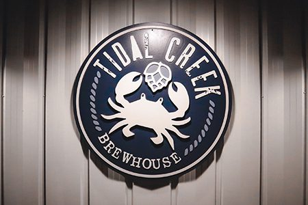 tidal creek brewhouse sign on a wall